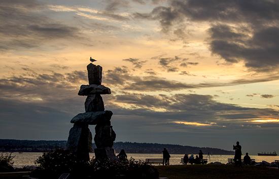 English bay Vancouver. Inukshuk sunset